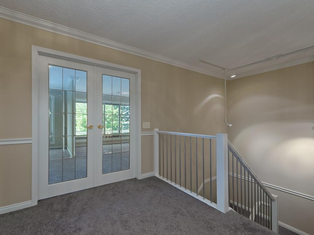 Double french doors leading to the master bedroom.