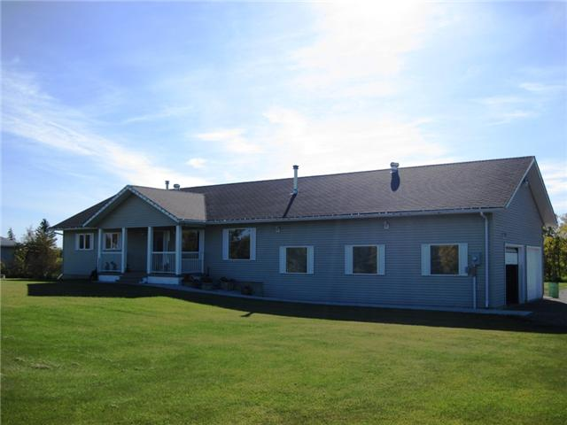"Main Photo: 12148 WEST BY PASS Road in Fort St. John: Fort St. John - Rural W 100th House for sale in ""FISH CREEK"" (Fort St. John (Zone 60))  : MLS®# N233953"
