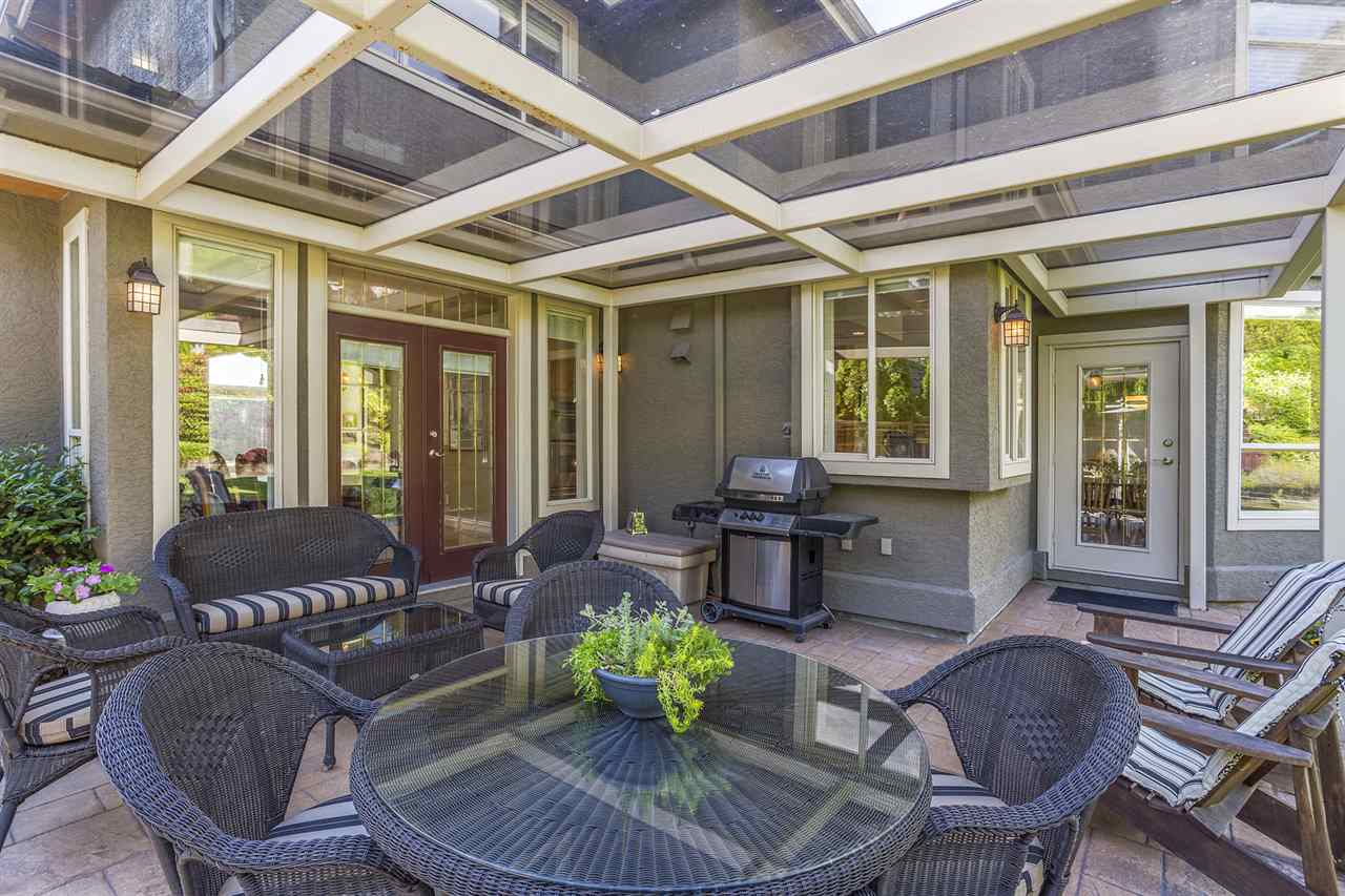 Outdoor living through the year under the cover of an incredible glass canopy.