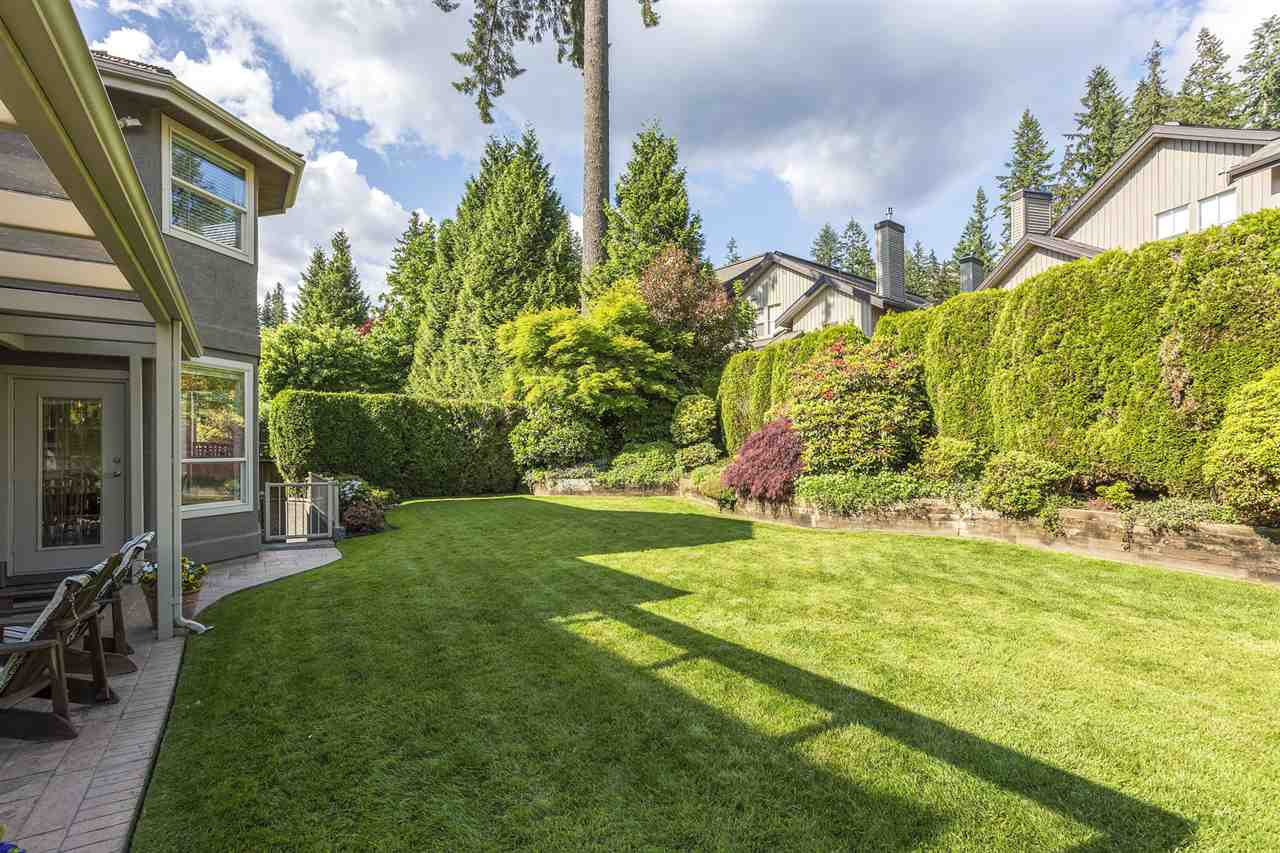 Very wide, level, backyard surrounded by lush manicured greenery. Watered by the in-ground sprinkler system.