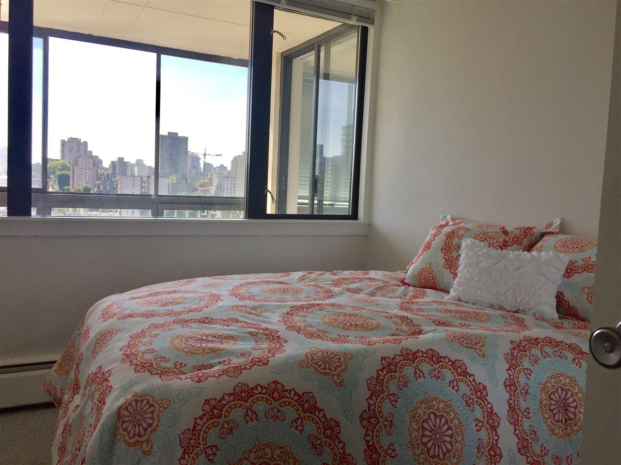 2nd bedroom with view of gardens and city