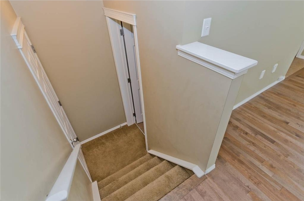 Door way to main floor 2 piece bathroom and to undeveloped basement