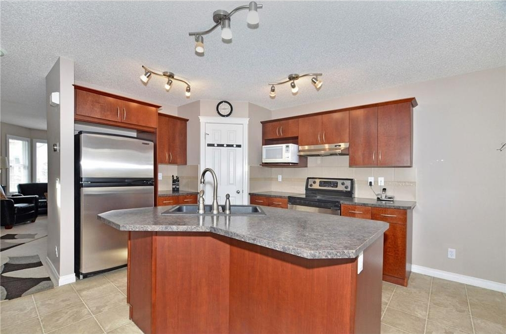 Large, open kitchen with corner pantry, stainless steel appliances, large island and roomy dining area
