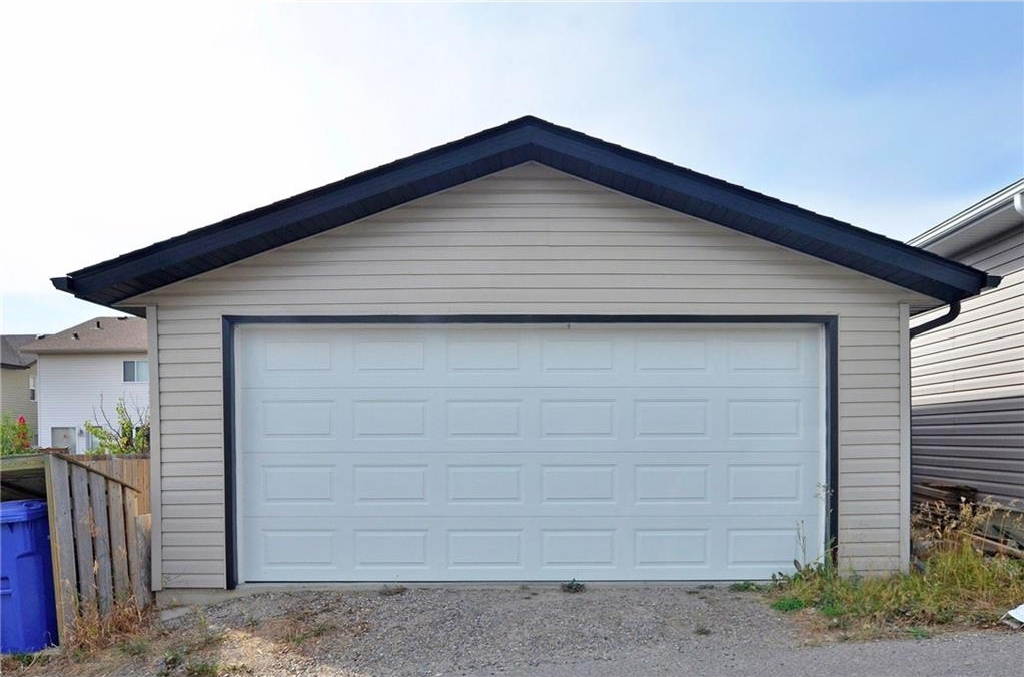 Double detached garage with back alley access