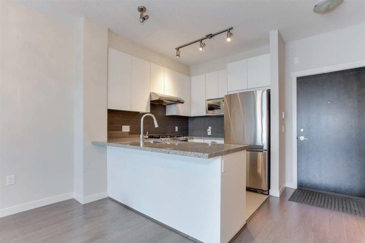 "Main Photo: 416 9388 MCKIM Way in Richmond: West Cambie Condo for sale in ""MAYFAIR PLACE"" : MLS® # R2190426"