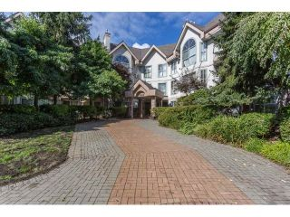 Main Photo: 104 7161 121 Street in Surrey: West Newton Condo for sale : MLS®# R2308592
