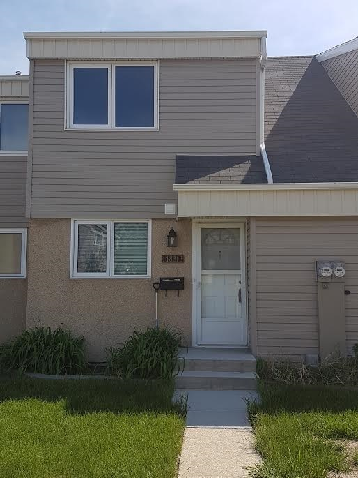 Main Photo: 14831B RIVERBEND Road in Edmonton: Zone 14 Townhouse for sale : MLS® # E4061708
