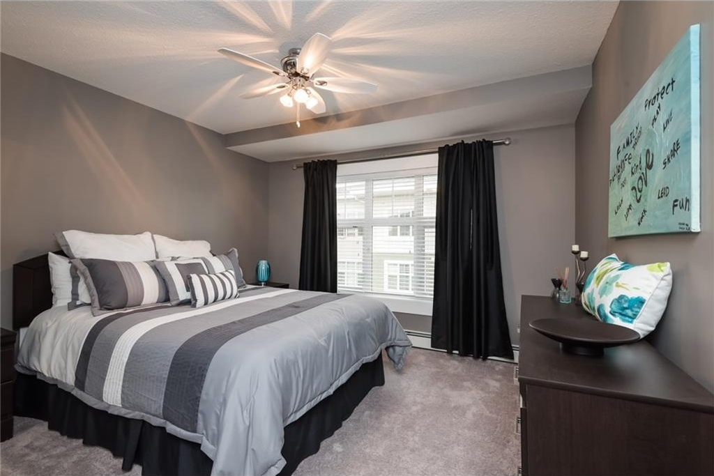 Spacious second bedroom with ample storage and closet space.