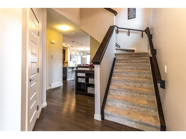 Spacious entrance with stairs upstairs. Open main floor level beyond.