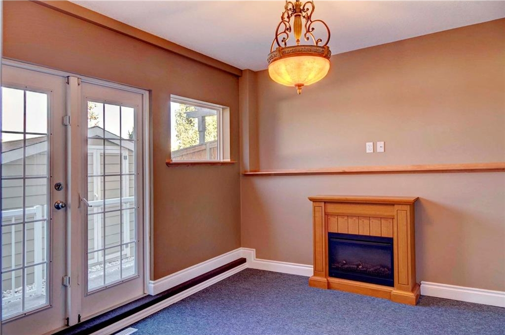 Three season, closed in sun room with electric fireplace in the walkout basement.