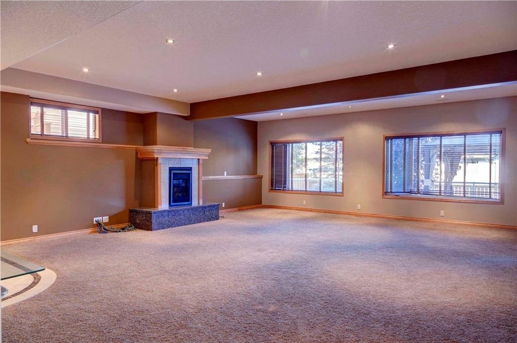Fully developed walkout basement with gas fireplace.