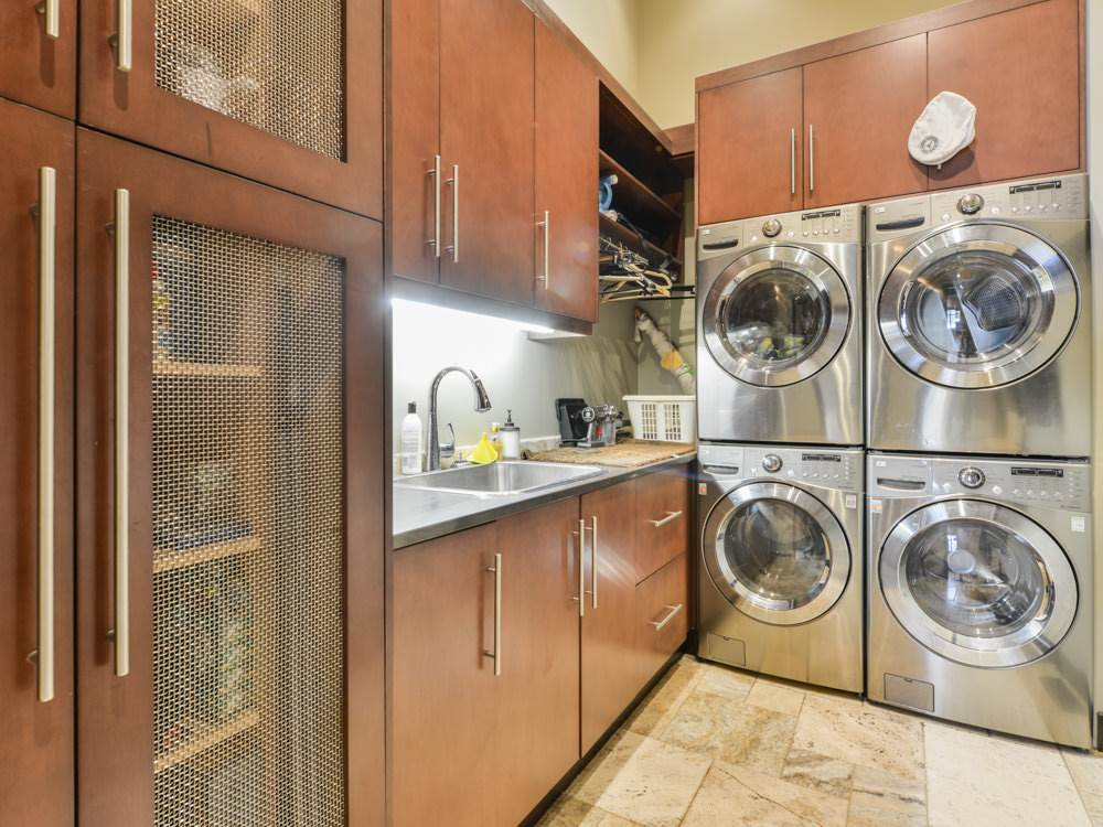 A laundry room to fall in love with! Full size, two washers and driers! Floor to ceiling cabinetry. Spacious!