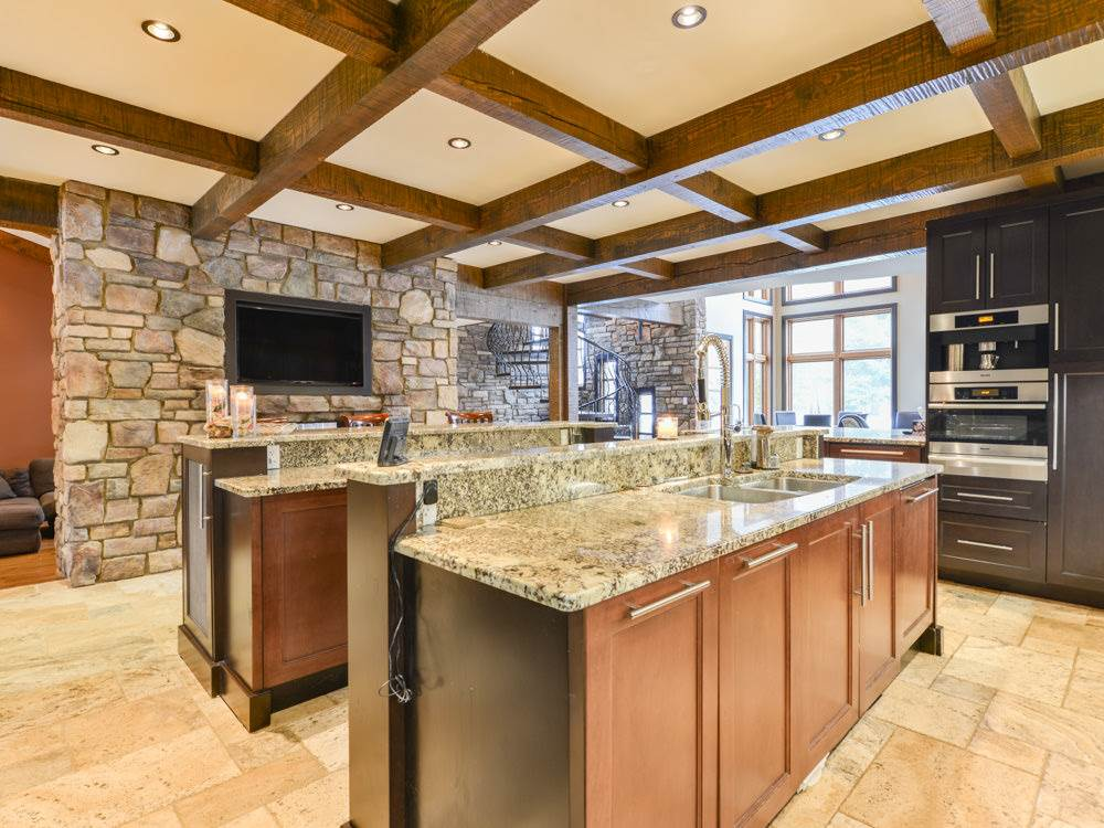 Master Chef's Kitchen! Two large islands allow plenty of space for preparing your master pieces and entertaining. Custom cabinetry throughout. Extensive granite counters, stone back splash.