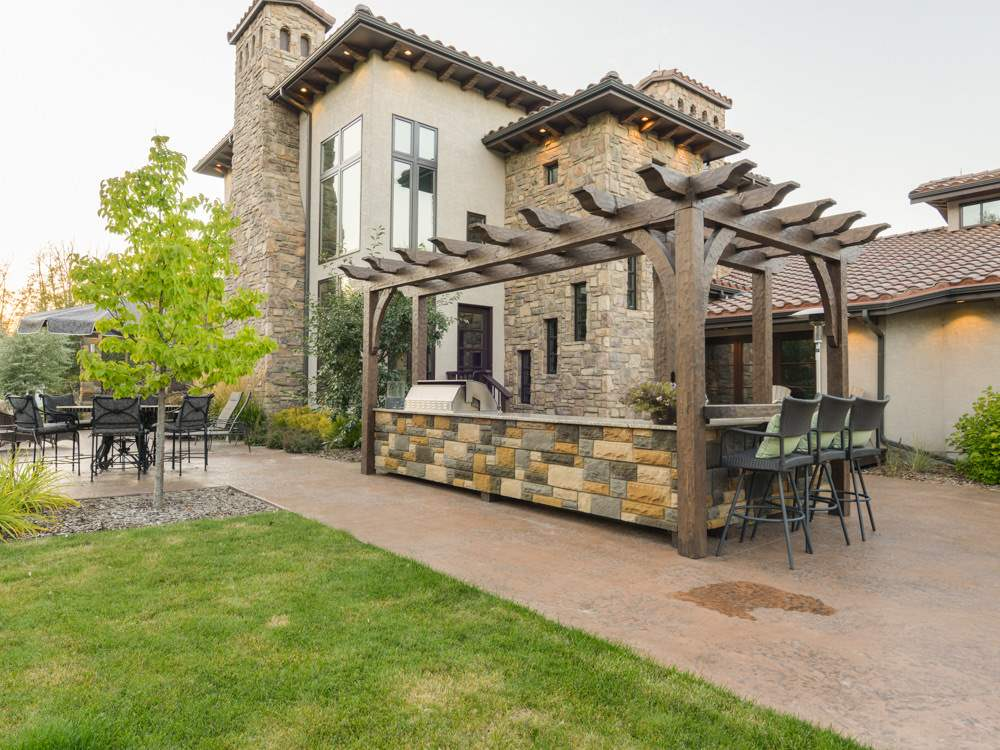 Barbeque patio area. Built-in barbeque, granite counters. Stone accents. Pergola covering.