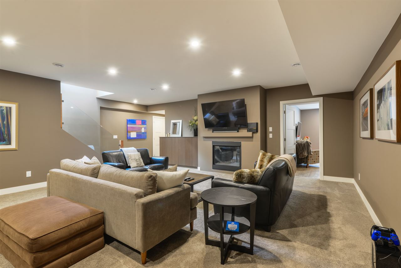 Large family room downstairs with surround sound, fireplace, and wet bar.