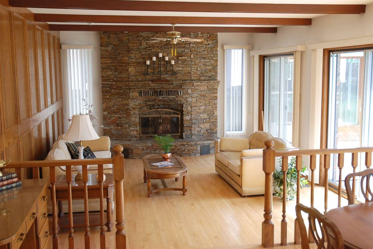 Awesome family room with stacked stone wood burning fireplace with gas log lighter.