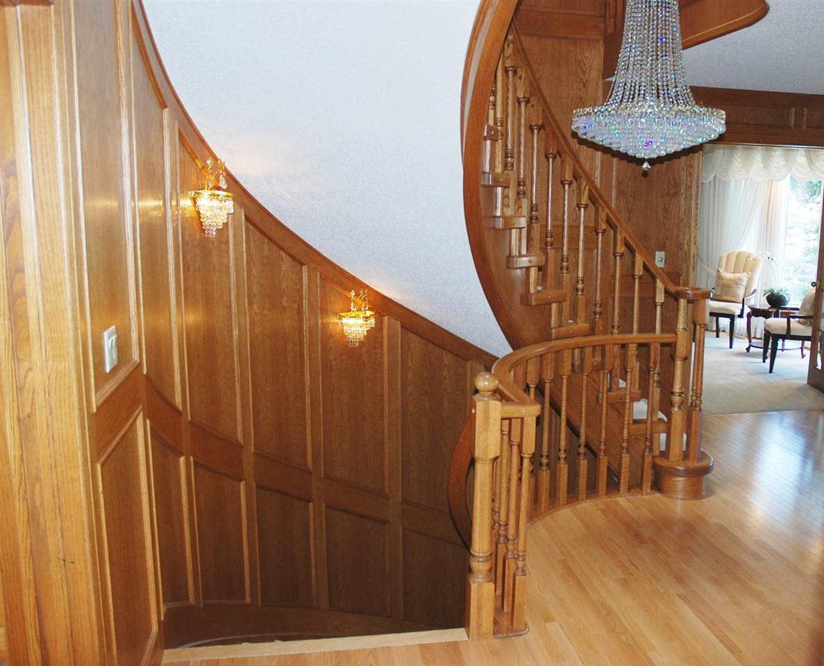 Beautiful curved staircase to basement and upper levels