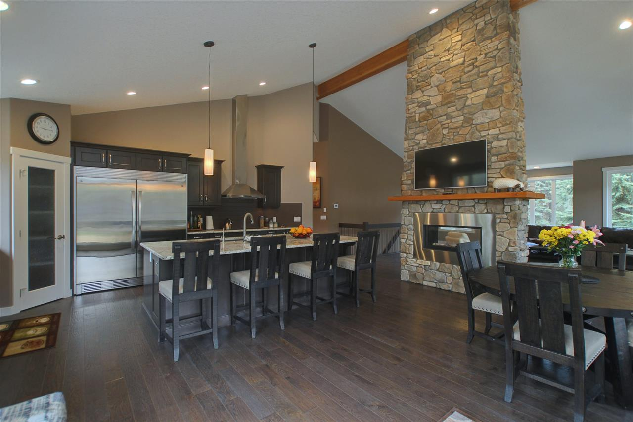Vaulted ceiling, LED lighting, floor to ceiling two-way stone fireplace.
