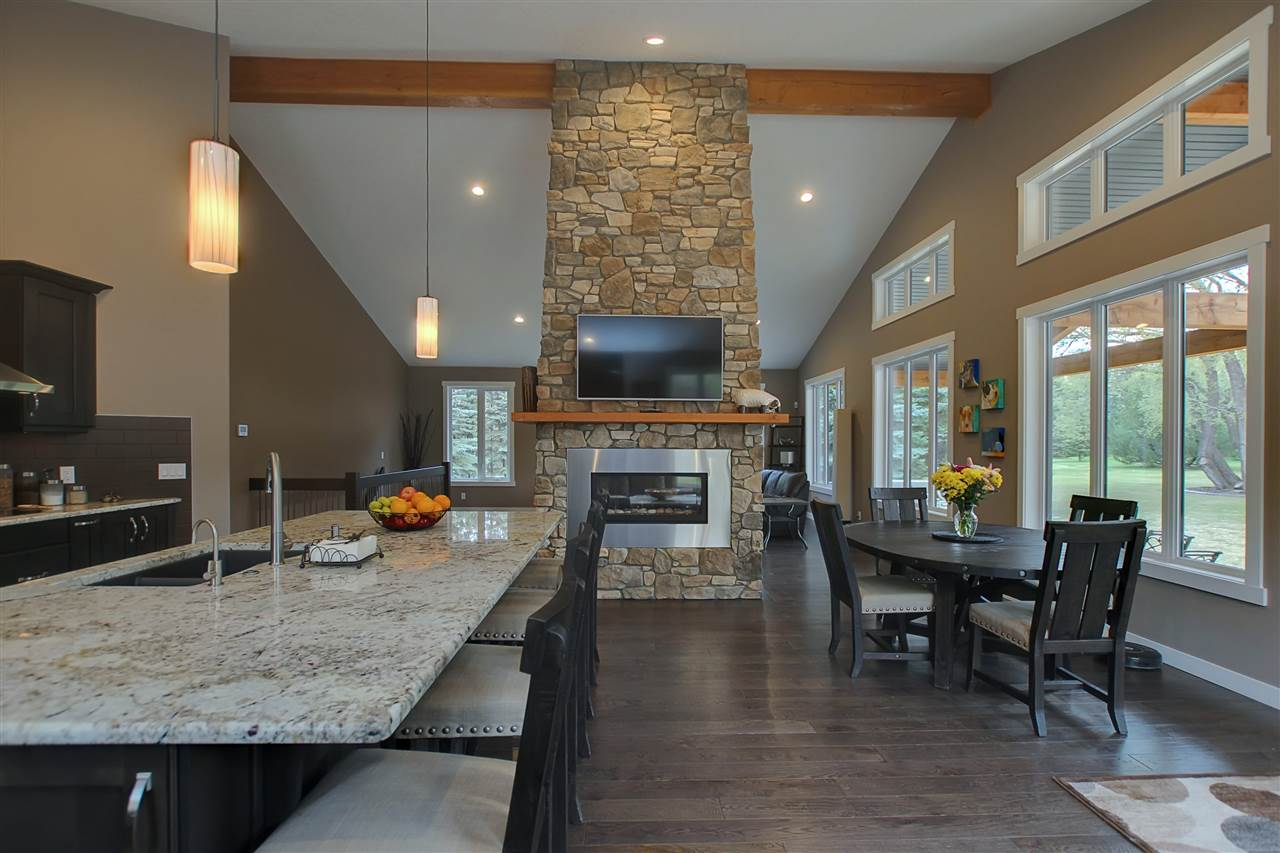Granite counters and an oversized granite island with eating/serving bar open to dining area.