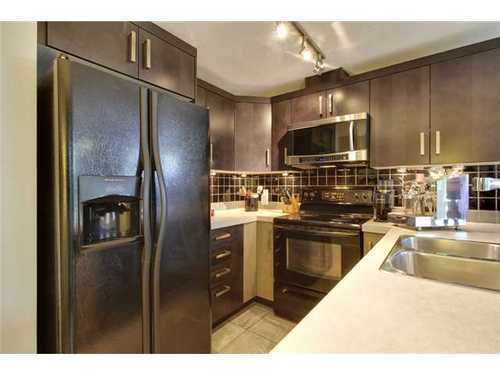 Main Photo: 310 1 Street SE in Calgary: Single Level Apartment for sale : MLS®# C3548056