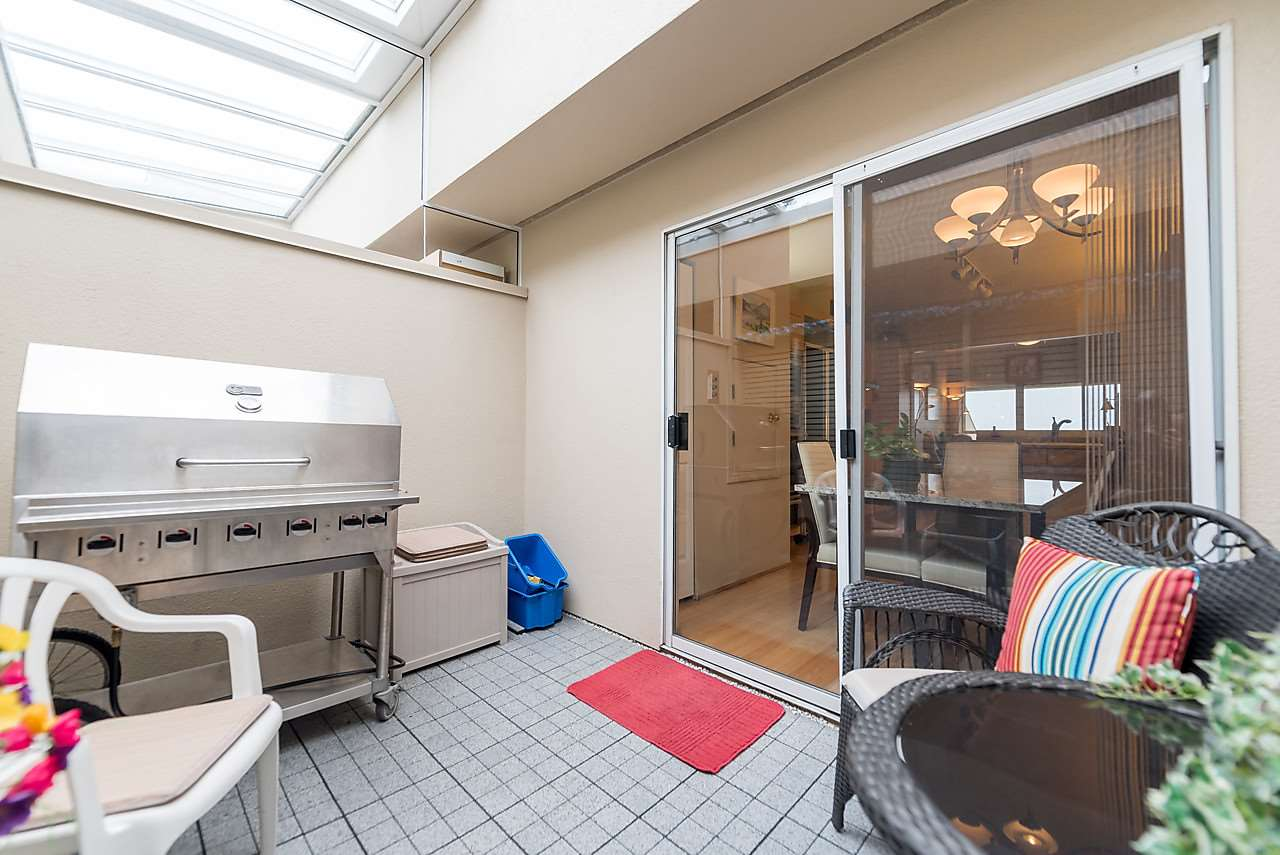 This solarium-like deck just off the kitchen eating area is covered by glass and has gas for your BBQ.