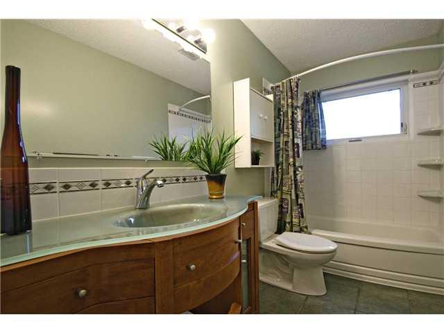 Photo 10: 3611 LOGAN Crescent SW in CALGARY: Lakeview Residential Detached Single Family for sale (Calgary)  : MLS® # C3580842