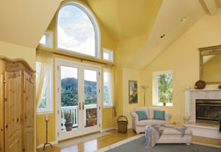 An archtop replacement window over French patio doors is a stunning improvement to the home.
