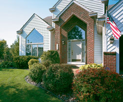 A trapezoid accent replacement window over the front door adds curb appeal to a home.