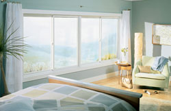 Gliding replacement windows add a stylish, modern touch to a bedroom. They slide open and make a great home improvement project.