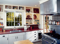Glider windows installed over a sink open easily for fresh air while cooking.  A great idea for replacement windows in the kitchen.