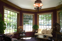 Replacement picture windows combined with traditional wood interiors and divided light grilles create a classic ambiance in a home.