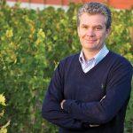 Almaviva winemaker Michel Friou in front of vines
