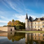 A pool reflects back the exterior of Pichon Baron's turreted, 19th-century château.