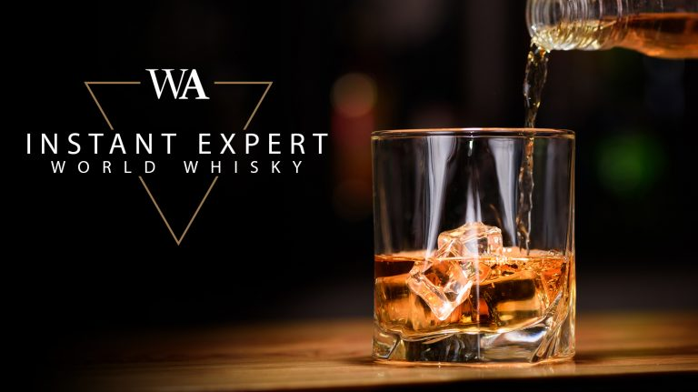 """Bottle filling a rocks glass with whisky with the words """"Instant Expert World Whisky"""" and Whisky Advocate logo."""