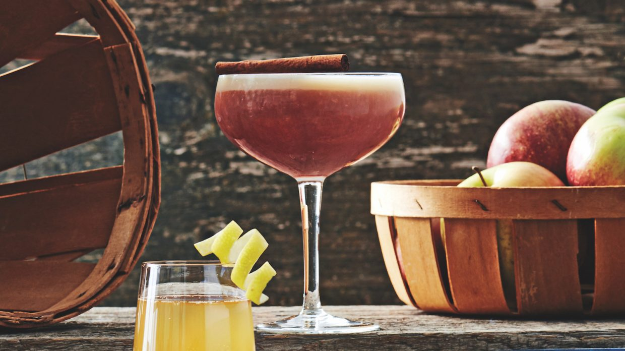 coupe glass with reddish whiskey cocktail