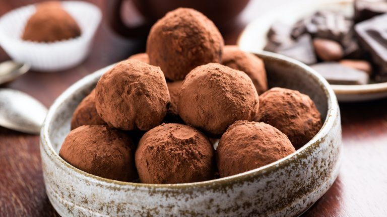 cocoa dusted bourbon balls in a dish