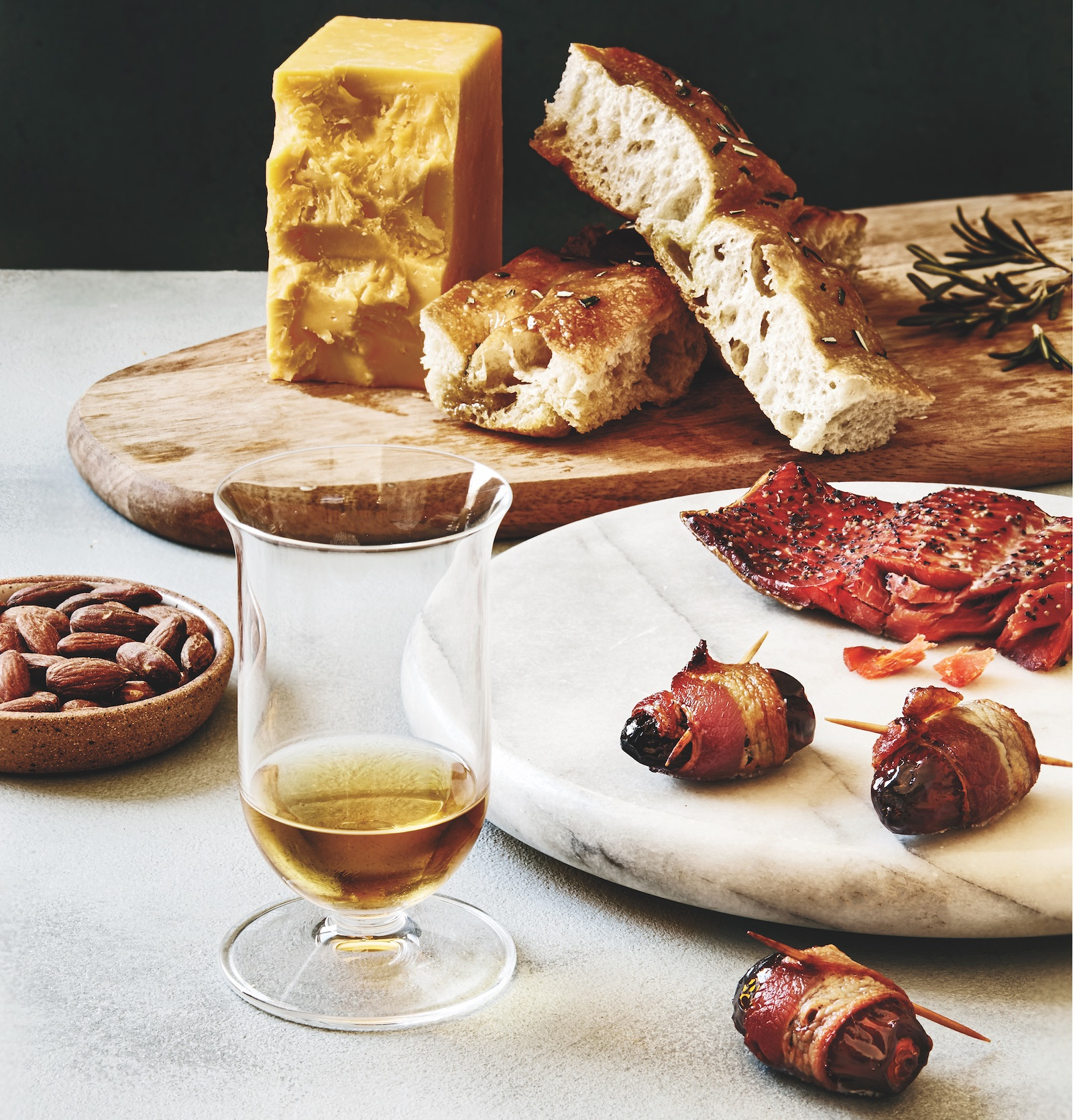 focaccia, cheddar, bacon-wrapped dates, almonds, smoked salmon with a glass of sherried single malt scotch