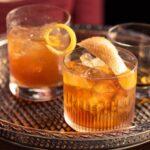 sazerac and bourbon cocktails on a silver tray