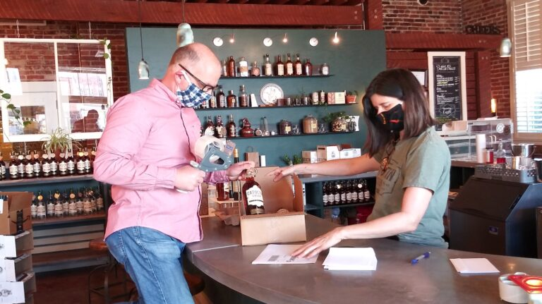 Purcellville, Virginia-based Catoctin Creek Distilling Co.'s co-founders, Scott and Becky Harris, package bottles for shipping on May 1.