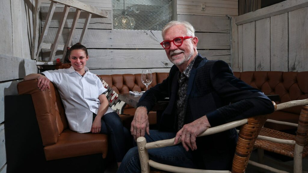 chef alison settle and steve wilson of hermitage farm seated at a table