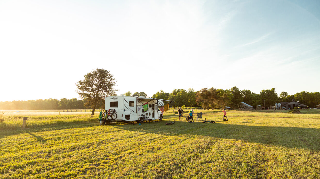 An RV sits on the farm of Iron Fish Distillery.