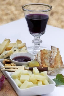 Cheese tasting and red wine glass on a table