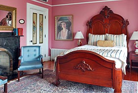 Antique mahogany queen-sized bed in Beatrice's Room at Cliffside Inn