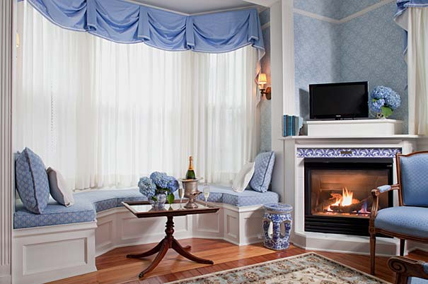 Gas Fireplace and Bay Window Seat in Our Newport Suite