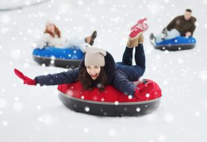 people tubing on skiing slopes