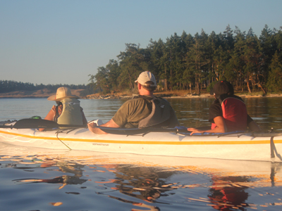 kayaking in a triple kayak off san juan island family of three
