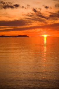 A beautiful sunset over the Strait of Juan de Fuca in Sequim Washington.