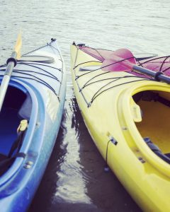Colorful kayaks on the water