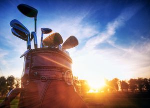 retire to sequim Professional golf gear on the golf course at sunset.