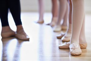 Teacher And Children's Feet In Ballet Dancing Class